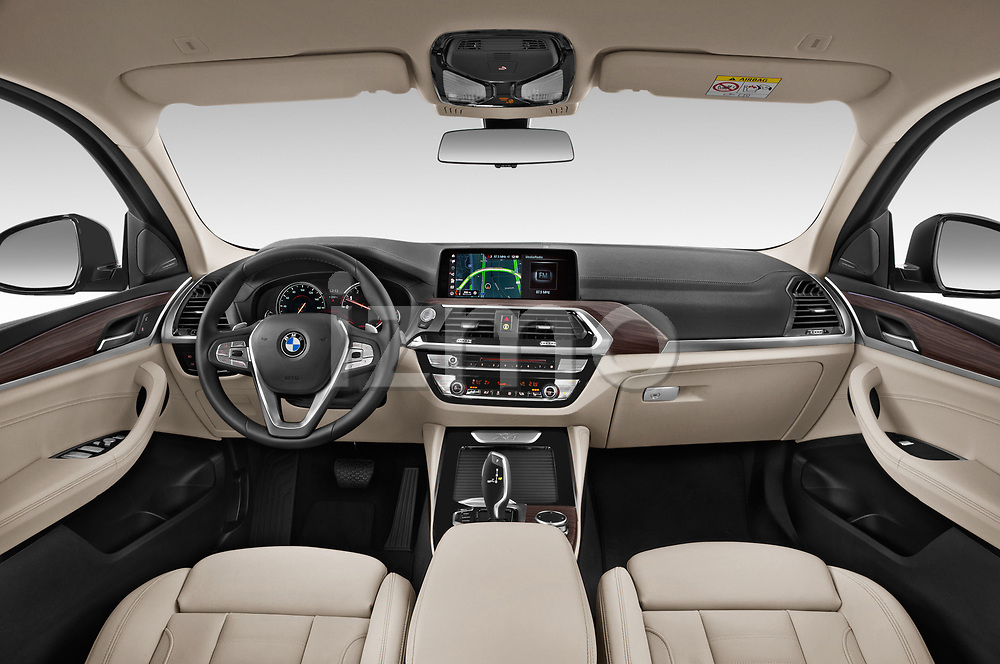Stock photo of straight dashboard view of a 2020 BMW X4 xDrive30i 5 Door SUV