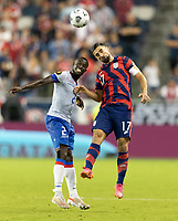 KANSAS CITY, KS - JULY 11: Carlens Arcus #2 of Haiti battles with Sebastian Lletget #17 of the USA during a game between Haiti and USMNT at Children's Mercy Park on July 11, 2021 in Kansas City, Kansas.