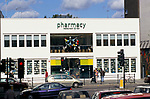 Pharmacy Bar, Restaurant owned by Damien Hirst, Notting Hill West London 1999 1990s.  Art works in the window.