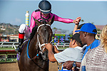 DEL MAR, CA  JULY 21:  #10 War Heroine, ridden by Tyler Baze, return to the connections after winning the San Clemente Handicap (Grade ll) on July 21, 2018, at Del Mar Thoroughbred Club in Del Mar, CA(Photo by Casey Phillips/Eclipse Sportswire/Getty Images)