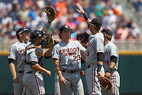 Oregon State pitcher Andrew Moore (23) is surrounded by  his teammates prior to the start of Game 11 at the 2013 Men's College World Series against the Mississippi State Bulldogs on June 21, 2013 at TD Ameritrade Park in Omaha, Nebraska. The Bulldogs defeated the Beavers 4-1, to reach the CWS Final and eliminating Oregon State from the tournament. (Andrew Woolley/Four Seam Images)
