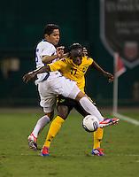 Victor Turcios (5) of El Salvador fights for the ball with Darren Mattocks (17) of Jamaica at RFK Stadium in Washington, DC.  Jamaica defeated El Salvador, 2-0.