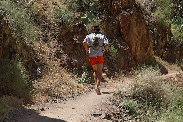 Trail runner at Phantom Ranch in Grand Canyon National Park, Arizona. . John offers private photo tours in Grand Canyon National Park and throughout Arizona, Utah and Colorado. Year-round.