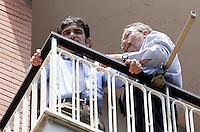 Gli avvocati Antonio Conte ed Enrico Gabrielli, a destra, si affacciano dal balcone dello studio del magistrato Cesare Ruperto durante una pausa della riunione del collegio arbitrale per la vertenza tra Italpetroli ed Unicredit, presso lo studio di Ruperto a Roma, 5 luglio 2010..UPDATE IMAGES PRESS/Riccardo De Luca