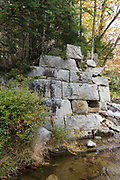 Remnants of a trestle along the abandoned Profile & Franconia Notch Railroad in Bethlehem, New Hampshire. This trestle crossed the Gale River. The railroad was in operation from 1879-1921 and only serviced the Profile House in Franconia Notch. This line was originally built as narrow gauge railroad then later converted to a standard gauge line.