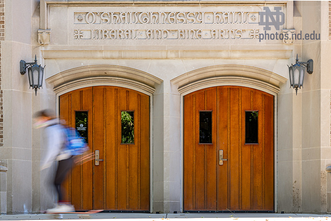 October 7, 2020; Student skateboards in front of the doors to the O'Shaughnessy great hall. (Photo by Matt Cashore/University of Notre Dame)
