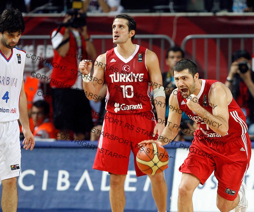 Omer ONAN (Turkey) and Kerem TUNCERI (Turkey) celebrates, Milos TEODOSIC (Serbia) left, during the semi-final World championship basketball match against Serbia in Istanbul, Serbia-Turkey, Turkey on Saturday, Sep. 11, 2010. (Novak Djurovic/Starsportphoto.com) .