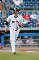 Norfolk Tides outfielder Daniel Alvarez (12) at bat during a game against the Louisville Bats at Harbor Park on April 26, 2016 in Norfolk, Virginia. Louisville defeated defeated Norfolk 7-2. (Robert Gurganus/Four Seam Images)