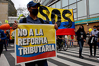 BOGOTA, COLOMBIA - APRIL 28 : People protest during a national strike Against the Duque package and the tax reform on April 28, 2021 in Bogota, Colombia. Colombia has the minimum wage around $ 250 per month where people are unhappy about corruption, unemployment, and inequality by Government. (Photo by Leonardo Munoz/VIEWpress)