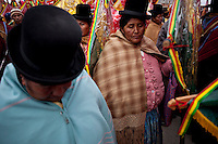 Aymara women during the parade to celebrate the day of El Alto.	Just 25 years ago it was a small group of houses around La Paz  airport, at an altitude of 12,000 feet. Now El Alto city  has  nearly one million people, surpassing even the capital of Bolivia, and it is the city of Latin America that grew faster .<br /> 	It is also a paradigmatic city of the tubles and traumas of the country. There got refugee thousands of miners that lost  their jobs in 90 ´s after the privatization and closure of many mines. The peasants expelled by the lack of land or low prices for their production. Also many who did not want to live in regions where coca  growers and the Army  faced with violence.<br /> 	In short, anyone who did not have anything at all and was looking for a place to survive ended up in El Alto.<br /> 	Today is an amazing city. Not only for its size. Also by showing how its inhabitants,the poorest of the poor in one of the poorest countries in Latin America, managed to get into society, to get some economic development, to replace their firs  cardboard houses with  new ones made with bricks ,  to trace its streets,  to raise their clubs, churches and schools for their children.
