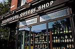 The Bedford Cheese Shop shows off boutique bottles of olive oil in its window on Bedford Street, Williamsburg near the East River in Brooklyn, New York.