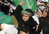 """A Palestinian child is wrapped in a green Islamic flag at a protest by the Islamic group Hamas against the upcoming U.S.-hosted Mideast peace conference, in Gaza City, Sunday, Nov. 25, 2007. Israeli, Palestinian, Arab and world leaders are set to meet in Annapolis, Maryland this week at a U.S. hosted peace conference.""""photo by Fady Adwan"""""""