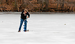 MIDDLEBURY,  CT-122619JS01- Tyler Stanley, 11, of Southbury, uses an ice auger to cut another hole as he, his father Mark Stanley and friend  Max Jurkowski,  spent Thursday afternoon doing some ice fishing on Lake Elise in the John Largay Preserve, part of the Middlebury Land Trust. <br /> Jim Shannon Republican-American