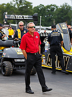 Aug 20, 2017; Brainerd, MN, USA; NHRA team owner Don Schumacher stands alongside the top fuel dragster driven by his son Tony Schumacher during the Lucas Oil Nationals at Brainerd International Raceway. Mandatory Credit: Mark J. Rebilas-USA TODAY Sports