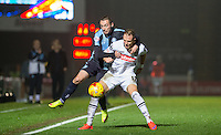 Michael Harriman of Wycombe Wanderers battles with Robert Milsom of Notts County during the Sky Bet League 2 match between Wycombe Wanderers and Notts County at Adams Park, High Wycombe, England on 15 December 2015. Photo by Andy Rowland.