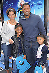 Nicole Murphy & Michael Strahan w/ kids at The Dreamworks Animation's Monsters VS. Aliens L.A. Premiere held at Gibson Ampitheatre in Universal City, California on March 22,2009                                                                     Copyright 2009 RockinExposures