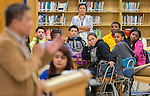 Students listen during a presentation of a prosthetic arm created with a 3D printer to 6-year-old Gracie at Washington High School, November 2, 2015.