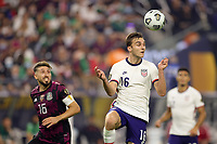 LAS VEGAS, NV - AUGUST 1: James Sands #16 of the United States goes up for a header during a game between Mexico and USMNT at Allegiant Stadium on August 1, 2021 in Las Vegas, Nevada.