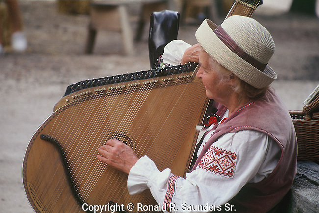 WOMAN PLAYS HARP AT COLORADO RENAISSACE FESTIVAL