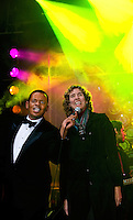 Charlotte Mayor Anthony Foxx and commissioner Jennifer Roberts welcome New Year's Eve revelers during First Night Charlotte 2010. The family-friendly public event (no alcohol allowed) is an annual cultural New Year's Eve celebration held in downtown / uptown / Charlotte center city. Charlotte First Night - An Imagination Celebration brought together artists, musicians, dancers and more from across the country. The New Year's event is organized by Charlotte Center City Partners, which facilitates and promotes the economic and cultural development of this North Carolina urban core.