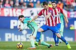 Lionel Andres Messi (l) of FC Barcelona fights for the ball with Gabriel Fernandez Arenas, Gabi, of Atletico de Madrid during their La Liga match between Atletico de Madrid and FC Barcelona at the Santiago Bernabeu Stadium on 26 February 2017 in Madrid, Spain. Photo by Diego Gonzalez Souto / Power Sport Images