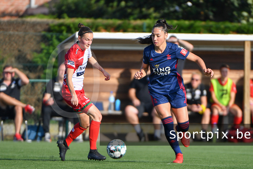 Elke Van Gorp (14) of Zulte Waregem and Amber Tysiak (3) of OH Leuven  pictured during a female soccer game between SV Zulte - Waregem and Oud Heverlee Leuven on the sixth matchday of the 2021 - 2022 season of Belgian Scooore Womens Super League , saturday 9 of October 2021  in Zulte , Belgium . PHOTO SPORTPIX | DIRK VUYLSTEKE