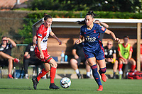 Elke Van Gorp (14) of Zulte Waregem and Amber Tysiak (3) of OH Leuven  pictured during a female soccer game between SV Zulte - Waregem and Oud Heverlee Leuven on the sixth matchday of the 2021 - 2022 season of Belgian Scooore Womens Super League , saturday 9 of October 2021  in Zulte , Belgium . PHOTO SPORTPIX   DIRK VUYLSTEKE