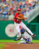 6 June 2009: Washington Nationals' second baseman Anderson Hernandez turns a double play, one of 5 completed by the Nationals during game action against the New York Mets at Nationals Park in Washington, DC. The Nationals defeated the Mets 7-1, with pitcher John Lannan going the distance for his first career complete-game. Mandatory Credit: Ed Wolfstein Photo