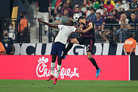 LAS VEGAS, NV - AUGUST 1: Gyasi Zardes #9 of the United States goes up for a header with Nestor Araujo #2 of Mexico during a game between Mexico and USMNT at Allegiant Stadium on August 1, 2021 in Las Vegas, Nevada.