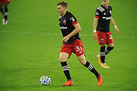WASHINGTON, DC - OCTOBER 28: Chris Julian Gressel #31 of D.C. United moves the ball during a game between Columbus Crew and D.C. United at Audi Field on October 28, 2020 in Washington, DC.