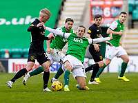 21st April 2021; Easter Road, Edinburgh, Scotland; Scottish Premiership Football, Hibernian versus Livingston; Jackson Irvine of Hibernian and Craig Sibbald of Livingston compete for possession of the ball