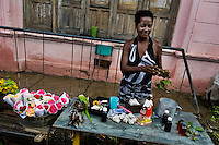 A Cuban woman sells natural objects (shells, plants, feathers,...) considered as magic elements in the Palo religion, Santiago de Cuba, Cuba, August 1, 2009. The Palo religion (Las Reglas de Congo) belongs to the group of syncretic religions which developed in Cuba amongst the black slaves, originally brought from Congo during the colonial period. Palo, having its roots in spiritual concepts of the indigenous people in Africa, worships the spirits and natural powers but can often give them faces and names known from the Christian dogma. Although there have been strong religious restrictions during the decades of the Cuban Revolution, the majority of Cubans still consult their problems with practitioners of some Afro Cuban religion.