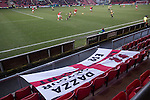Crewe Alexandra 1 Leyton Orient 2, 18/01/2014. Gresty Road, League One. A visiting fan's flag adorns the seats during the second half of Crewe Alexandra's home game against Leyton Orient (in yellow) in the SkyBet League One at the Alexandra Stadium, Gresty Road, Crewe. The match was won by the visitors from London by 2-1 with two goals on debut by Chris Dagnall, sending Orient to the top of the league. The match was watched by 4830 spectators. Photo by Colin McPherson.