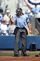 Home plate umpire Alex Mackay makes a call during a game between the Daytona Tortugas and Charlotte Stone Crabs on April 14, 2015 at Charlotte Sports Park in Port Charlotte, Florida.  Charlotte defeated Daytona 2-0.  (Mike Janes/Four Seam Images)