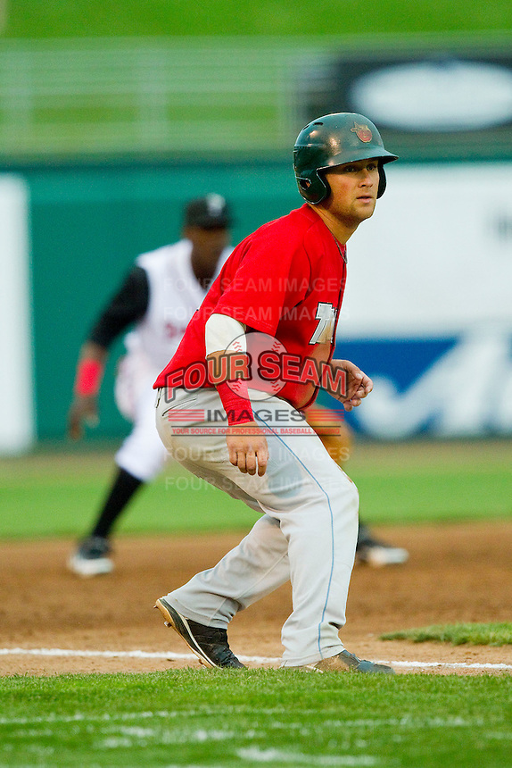 Maxx Tissenbaum (8) of the Fort Wayne TinCaps takes his lead off of third base against the Lansing Lugnuts at Cooley Law School Stadium on June 5, 2013 in Lansing, Michigan.  The TinCaps defeated the Lugnuts 8-5.  (Brian Westerholt/Four Seam Images)