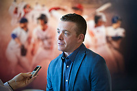 Darren Fenster, manager of the Greenville Drive from 2014-2017, is interviewed in front of a poster of past Drive stars during the annual Hot Stove Event to promote the upcoming baseball season on Monday, January 29, 2018, at Fluor Field at the West End in Greenville, South Carolina. (Tom Priddy/Four Seam Images)