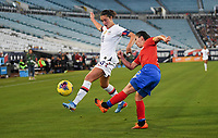 JACKSONVILLE, FL - NOVEMBER 10: Carli Loyd #10 of the United States attempts to move past Lixy Rodriguez #12 of Costa Rica during a game between Costa Rica and USWNT at TIAA Bank Field on November 10, 2019 in Jacksonville, Florida.