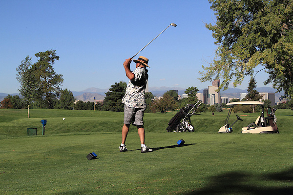 African-American man teeing off at City Park Golf Course, Denver, Colorado.