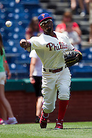 Philadelphia Phillies shortstop Jimmy Rollins #11 warms up before the Major League Baseball game against the Pittsburgh Pirates on June 28, 2012 at Citizens Bank Park in Philadelphia, Pennsylvania. The Pirates defeated the Phillies 5-4. (Andrew Woolley/Four Seam Images)