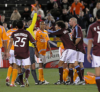 Referee Mark Geiger shows Colorado's Conor Casey a red card. The Houston Dynamo defeated the Colorado Rapids 3-1 at Dick's Sporting Goods Park, Denver, Colorado. Saturday, October 4, 2008. Photo by Trent Davol/isiphotos.com.