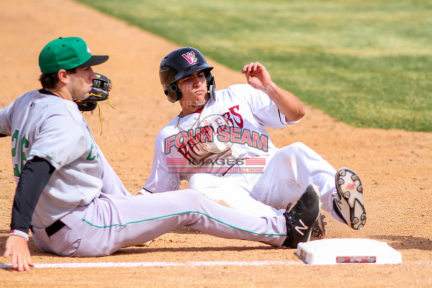 Wisconsin Timber Rattlers catcher Brent Diaz (18) slides into third base during a Midwest League game against the Clinton LumberKings on April 26, 2018 at Fox Cities Stadium in Appleton, Wisconsin. Clinton defeated Wisconsin 7-3. (Brad Krause/Four Seam Images)