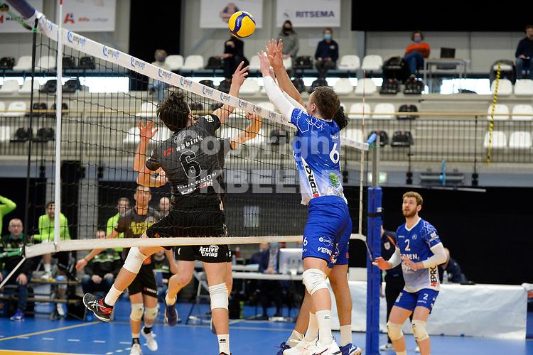 06-03-2021: Volleybal: Amysoft Lycurgus v Active Living Orion: Groningen Orion speler Markus Held in duel met blok met Lycurgus speler Thomas - Douglass-Powell