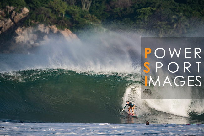 US big wave surfer Bianca Valenti rides a wave at Puerto Escondido's Zicatela Beach in Mexico. Photo by Victor Fraile / Power Sport Images