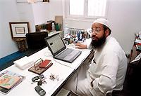 - Abu Imad, imam of the Muslim Center  of Jenner avenue ....- Abu Imad, imam del Centro culturale Islamico di viale Jenner nel suo ufficio..