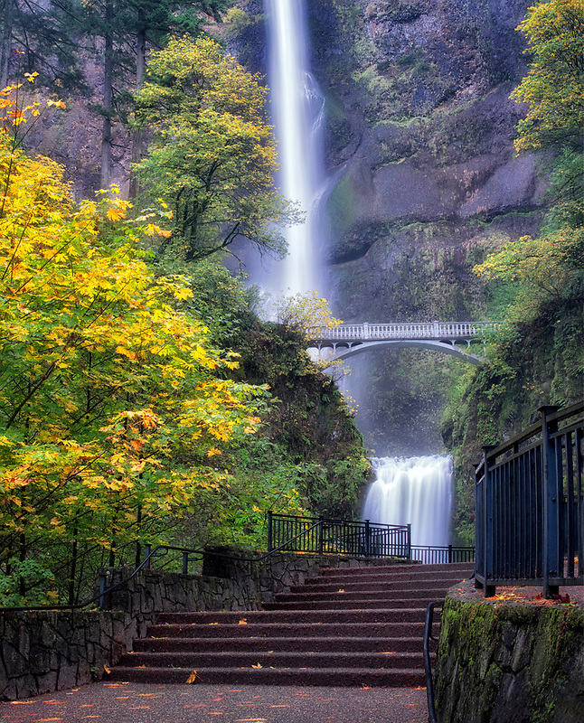 Multnomah Falls. with pathway and fall color. Columbia River Gorge National Scenic Area, Oregon