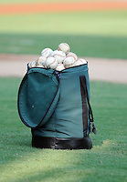 A bag of baseballs sits on the field prior to a game between the Savannah Sand Gnats and the West Virginia Power on July 21, 2011, at Grayson Stadium in Savannah, Georgia. (Tom Priddy/Four Seam Images)