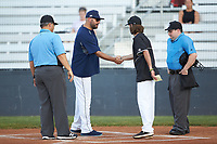 Mooresville Spinners head coach Tripp Hamrick (right) shakes hands with the head coach of the Carolina Venom as umpires Brian Sain (left) and Adam Ohlmann (right) look on at Moor Park on June 22, 2020 in Mooresville, NC.  The Spinners defeated the Venom 7-2. (Brian Westerholt/Four Seam Images)