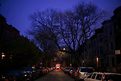 April 21, 2020<br /> Brooklyn, New York<br /> Park Slope<br /> <br /> A lone garbage truck on the streets of Brooklyn at dawn at the height of the coronavirus pandemic.