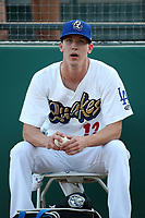Walker Buehler (12) of the Rancho Cucamonga Quakes sits in the bullpen before pitching against the Inland Empire 66ers at LoanMart Field on April 21, 2017 in Rancho Cucamonga, California. Rancho Cucamonga defeated Inland Empire 5-4. (Larry Goren/Four Seam Images)