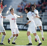 Maryland's Marc Burch (15) is congratulated by teammates David Glaudemans (3) and A.J. Delagarza (20) after scoring the game's only goal at 30:33. The University of Maryland Terrapins defeated the University of New Mexico Lobos 1-0 in the Men's College Cup Championship game at SAS Stadium in Cary, NC, Friday, December 11, 2005.